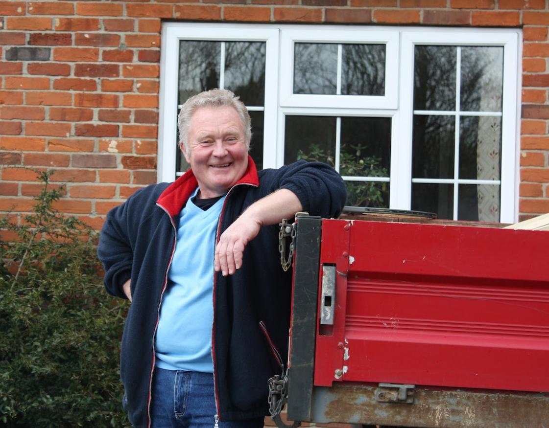Founder, Kevin Jones; leaning against a red truck.